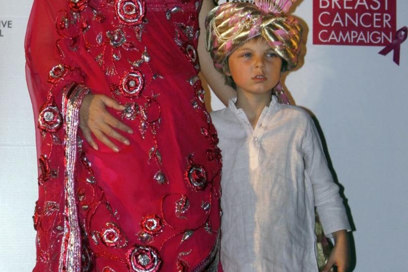 British actress Hurley poses with her son Damian during an event for the Breast Cancer Awareness in Mumbai