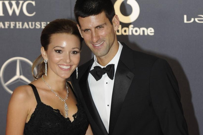 Tennis Player Novak Djokovic (R) and his girlfriend Jelena Ristic pose for photographs as they arrive for the the Laureus World Sports Awards 2012 in central London February 6, 2012.