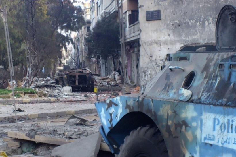 Two damaged armoured military vehicles are seen after clashes between President Bashar al-Assad forces and Free Syrian Army (FSA) in Cairo square near Khaldiyeh area in Homs