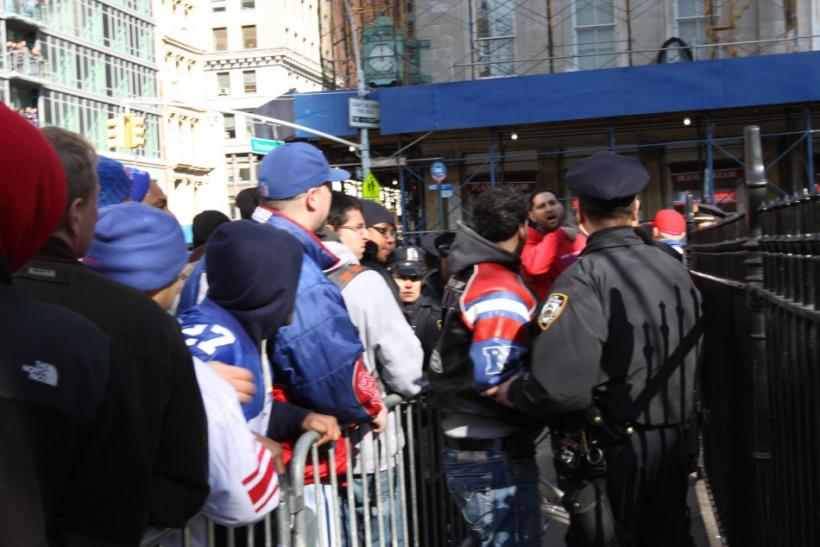 Giants Parade: Officers insists pedestrians return to the other side of the barricades