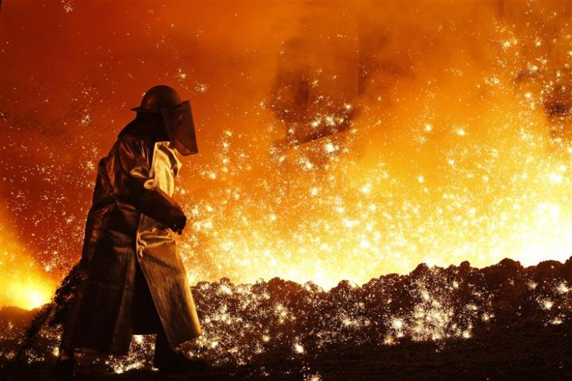 A worker controls the cast at a blast furnace at a steel manufacture
