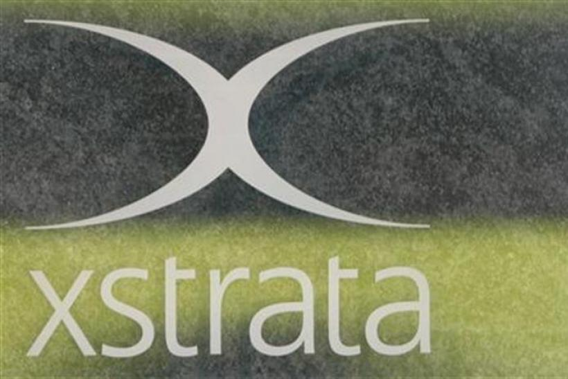 A logo of the Swiss mining company Xstrata is shown at the Headquarters in Zug