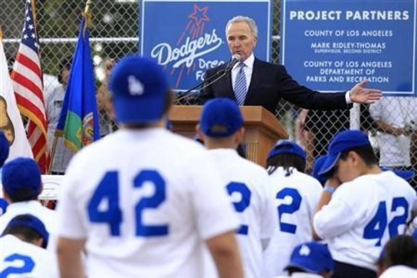Los Angeles Dodgers owner Frank McCourt speaks during the unveiling of a new Dodgers baseball field for children in Compton, Los Angeles, California