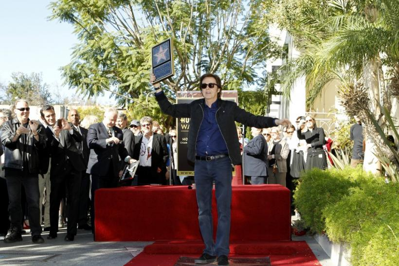 British singer Paul McCartney poses on his star after it was unveiled on the Walk of Fame in Hollywood, California