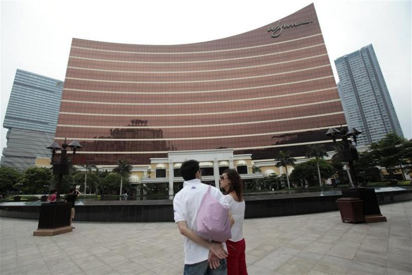 Tourists stand outside the Wynn Casino in Macau