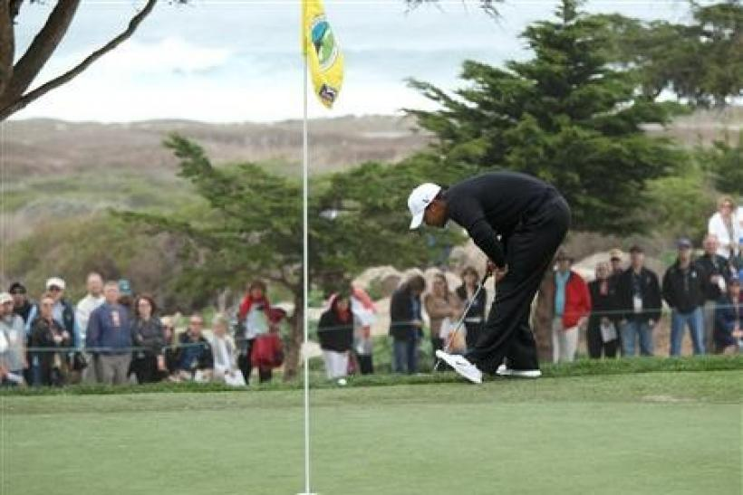 Tiger Woods looks over his shot from just off the green at the 11th hole during the second round of the AT&T Pebble Beach National Pro-AM golf tournament at Monterey Peninsula Country Club in Pebble Beach, California