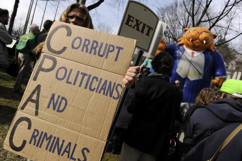 Protesters from the Occupy DC movement and labor unions gather outside the American Conservative Union's annual Conservative Political Action Conference (CPAC) prior to an address by Republican U.S. presidential candidate Mitt Romney in Washington, F