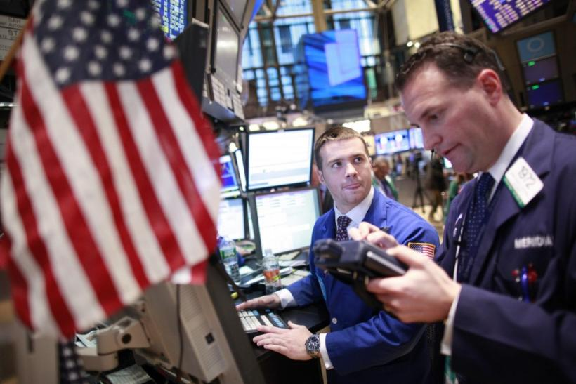Specialist trader Frank Masiello, left, takes an order from trader Jonathon Corpina on the floor of the New York Stock Exchange on Friday. Feb. 10, 2012