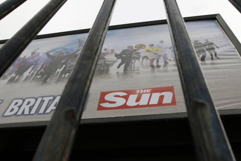 An advertisement for The Sun newspaper is seen on a billboard outside News International's Wapping headquarters in London on Jan. 28, 2012.