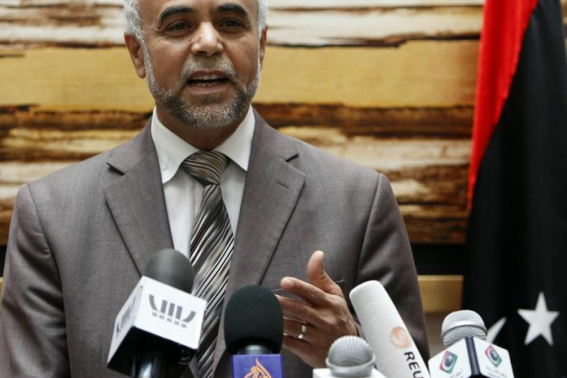Mohammed al-Harizy, a spokesman for the Libyan National Transitional Council (NTC), speaks at a news conference in Tripoli February 11, 2012.
