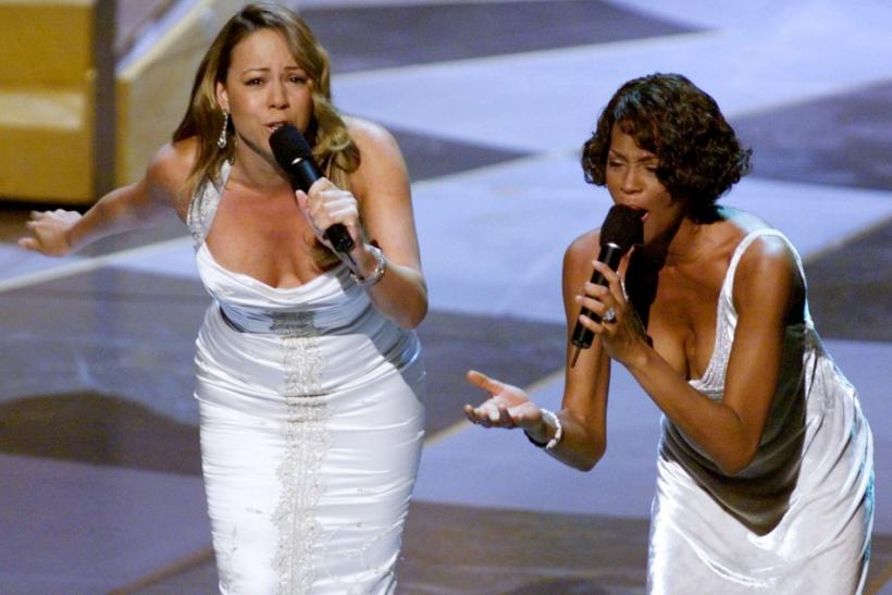 "Whitney Houston (R) and Mariah Carey sing the nominated song ""When You Believe,"" at the 71st Annual Academy Awards"