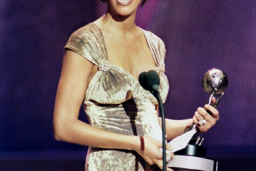 Singer Whitney Houston holds the Image Award she received for outstanding female recording artist
