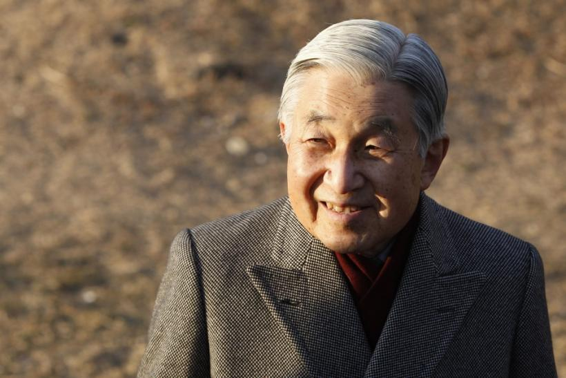 Japan's Emperor Akihito smiles as he talks with residents during a stroll near his imperial villa where he and his wife are staying in Hayama town, south of Tokyo February 2, 2012.