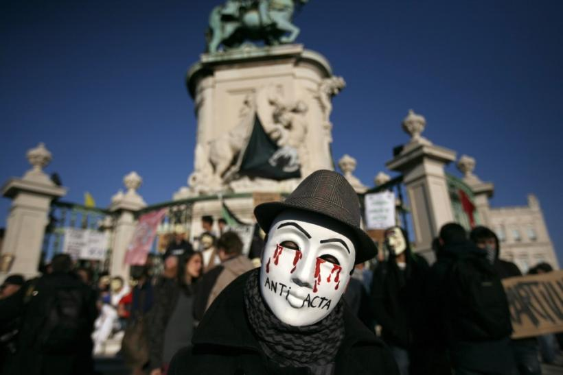 A demonstrator wears a Guy Fawkes mask during a protest in Lisbon February 11, 2012.