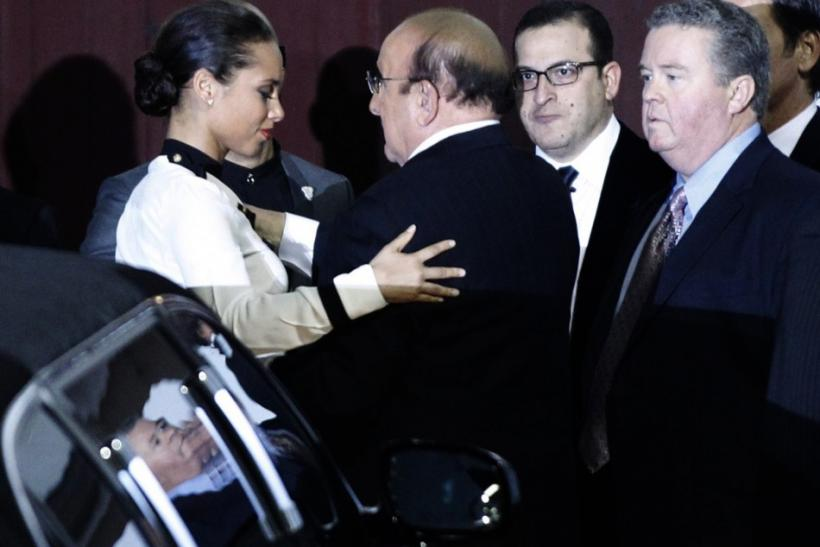 Singer Alicia Keys hugs record producer Clive Davis after Davis arrived for his pre-Grammy gala at the Beverly Hilton Hotel in Beverly Hills