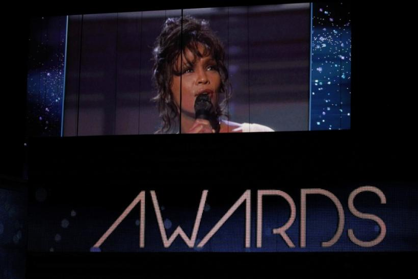 Singer Whitney Houston, who died on February 11, 2012, is shown on a video screen in a 1994 Grammy performance during the 54th annual Grammy Awards in Los Angeles, California