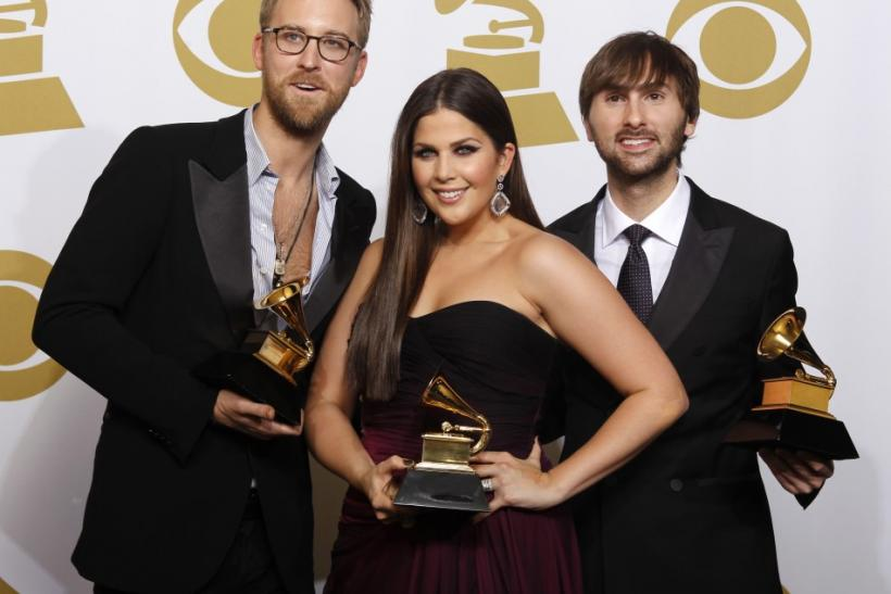 "Charles Kelley, Hillary Scott and David Haywood (L-R) of Lady Antebellum pose with their Grammy for Best Country Album (""Own The Night"") at the 54th annual Grammy Awards in Los Angeles, California"