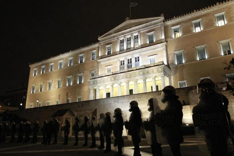 Riot police stand guard in front of the parliament during a protest against austerity measures in Athens