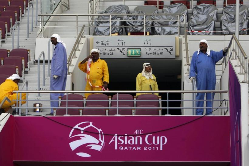 A group of workers clean Khalifa stadium in Doha