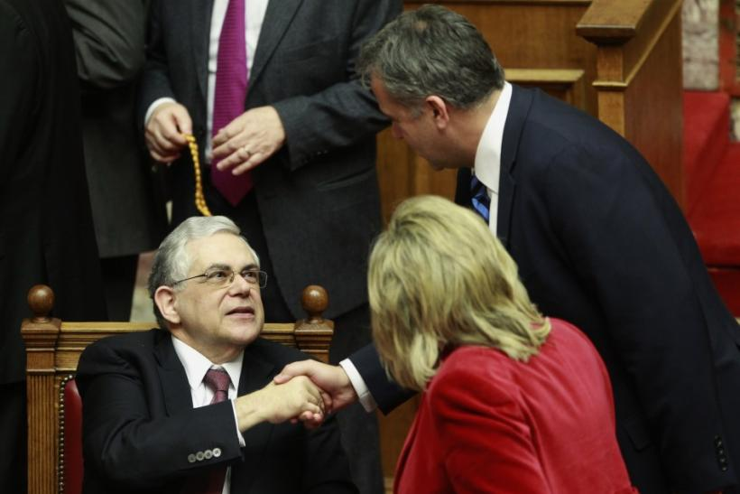 Greek PM Papademos receives congratulations as Greek lawmakers approved a new austerity deal in Athens