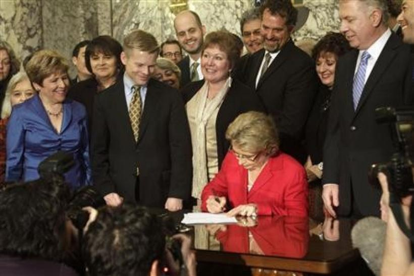 Washington state Governor Christine Gregoire signs legislation legalizing gay marriage in the state, in Olympia, Washington February 13, 2012.
