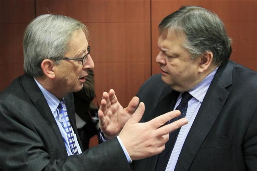 Luxembourg's Prime Minister and Eurogroup chairman Juncker talks with Greece's Finance Minister Evangelos Venizelos at the start of a Eurogroup meeting in Brussels