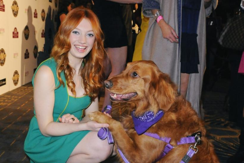 Actress Jacqueline Emerson and her dog Ginger arrive at the first annual Golden Collar Awards celebrating Hollywood's most talented canine thespians from Oscar nominated films and Emmy Award winning television shows in Los Angeles, California