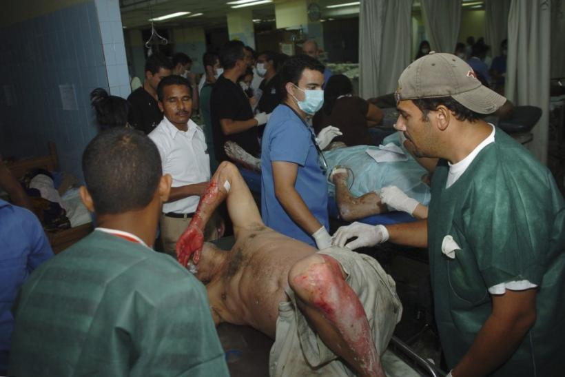 An injured man lies on a stretcher at Escuela hospital in the capital Tegucigalpa