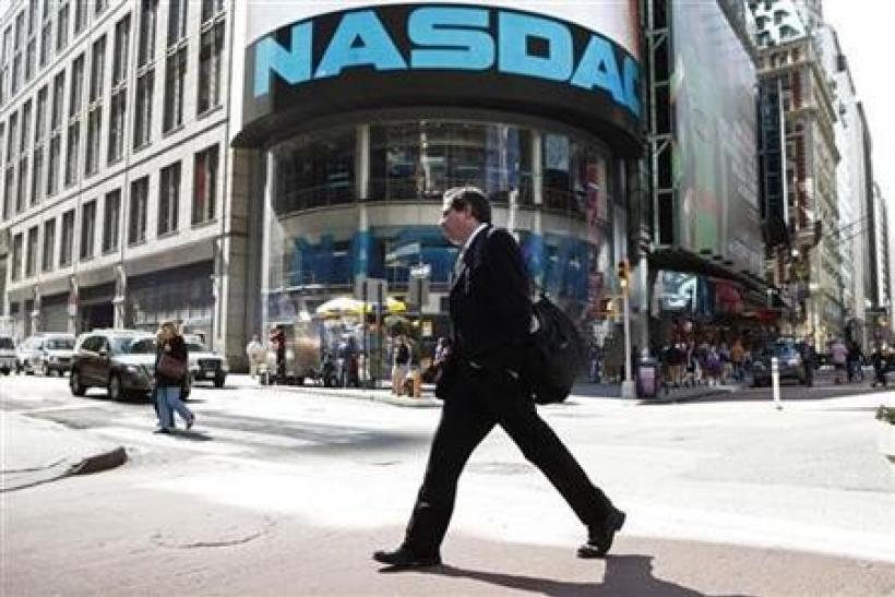 A pedestrian walks past the NASDAQ building in New York City, April 30, 2010.