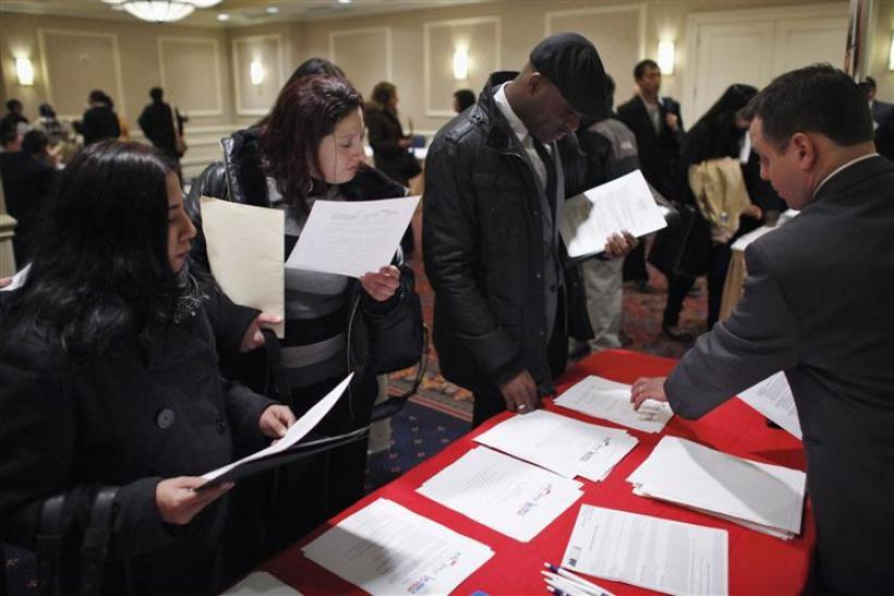 "People talk with a job recruiter while they attend the ""JobEXPO"" job fair in New York"
