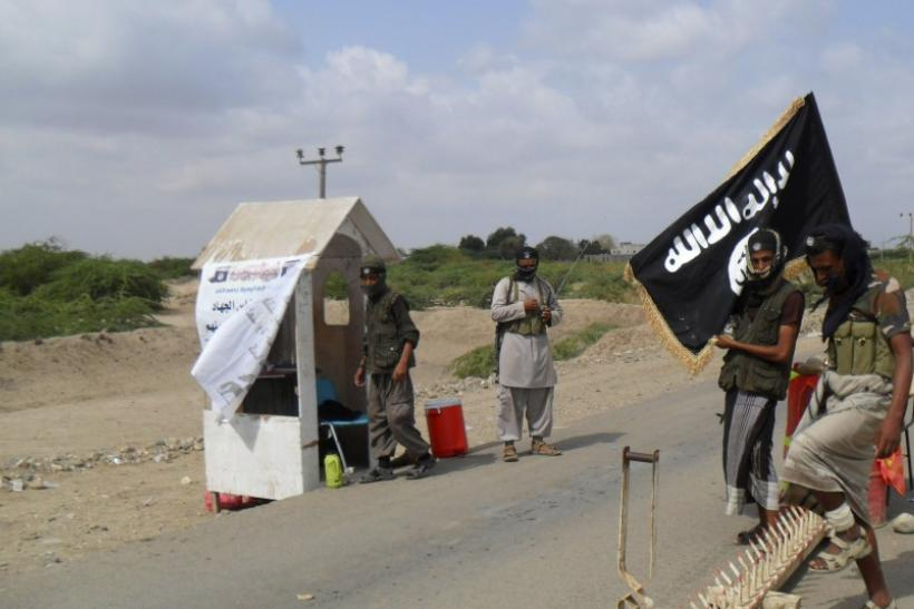 Al Qaeda militants man a checkpoint at the entrance of the southern Yemeni city of Zinjibar