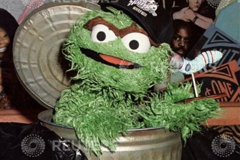 "Characters from the children's television programme ""Sesame Street"", Oscar the Grouch"" (L) and Slime.."