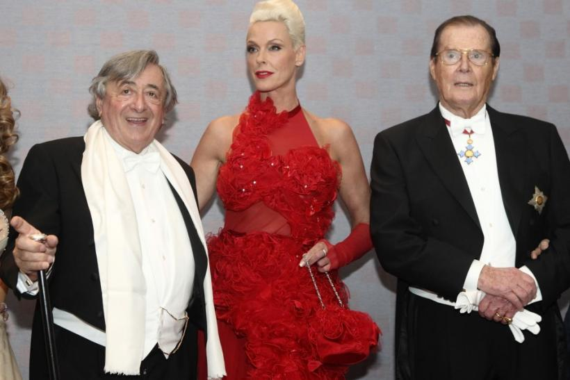 Austrian businessman Richard Lugner poses with Danish actress Brigitte Nielsen and British actor Roger Moore (L-R) ahead of the traditional Opera Ball in Vienna, February 16, 2012.