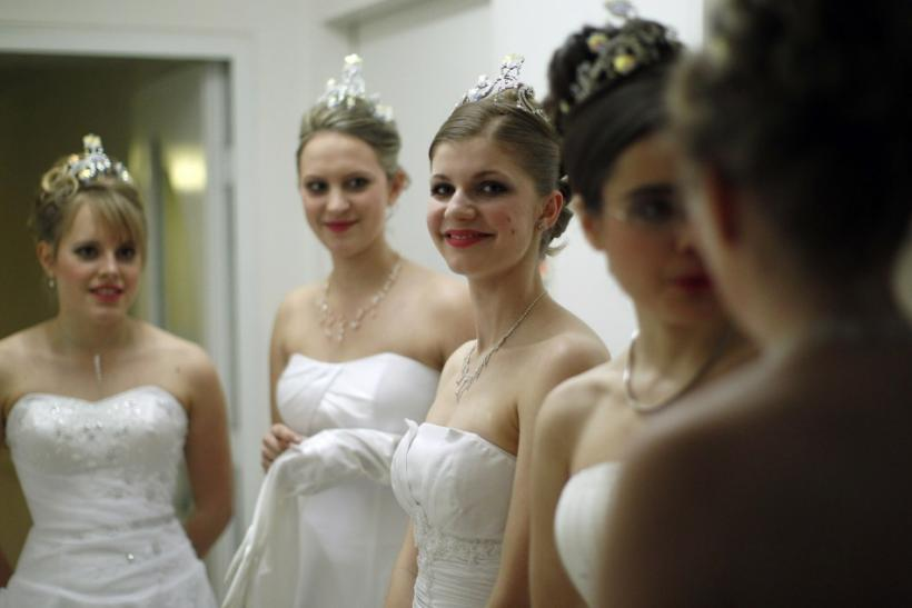 Dancers from the Young Ladies' Committee get ready prior to the opening ceremony at the traditional Opera Ball in Vienna