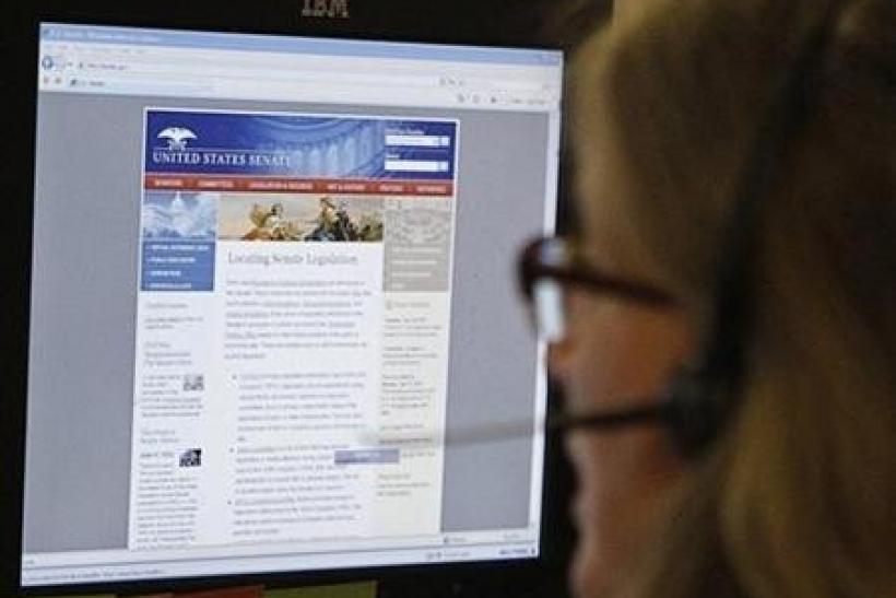A journalist checks the U.S. Senate's website after it was attacked in 2011.