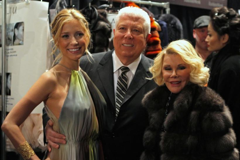 Kristin Cavallari, designer Dennis Basso and actress Joan Rivers pose for photographs backstage before a showing of the Dennis Basso Fall/Winter 2012 collection during the New York Fashion Week February 14, 2012.