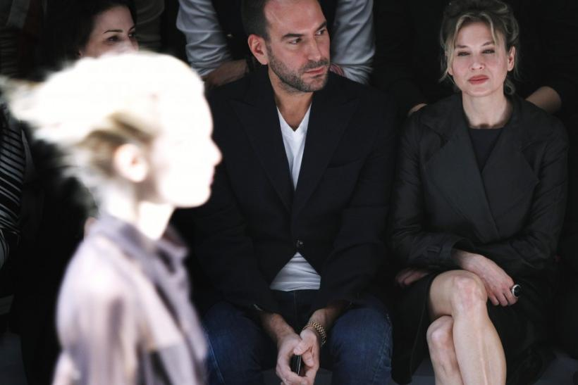 Actress Renee Zellweger (R) watches a model during a presentation of the Vera Wang Fall/Winter 2012 collection during New York Fashion Week February 14, 2012.