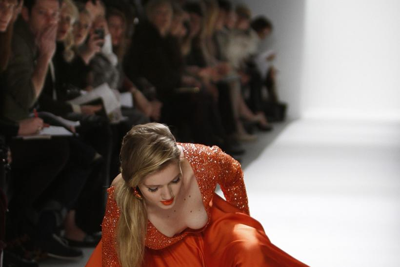 A model falls while presenting a creation at the Dennis Basso Fall/Winter 2012 collection show during New York Fashion Week February 14, 2012