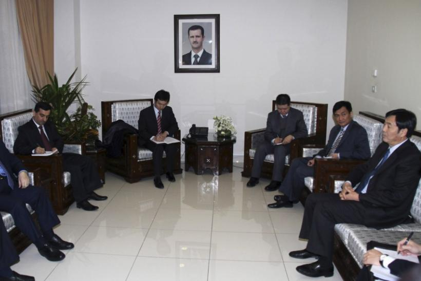 Syrian Deputy Foreign Minister Faisal Mekdad (first L) meets Chinese Vice Foreign Minister Zhai Jun (first R) and other senior diplomats, in Damascus February 17, 2012.