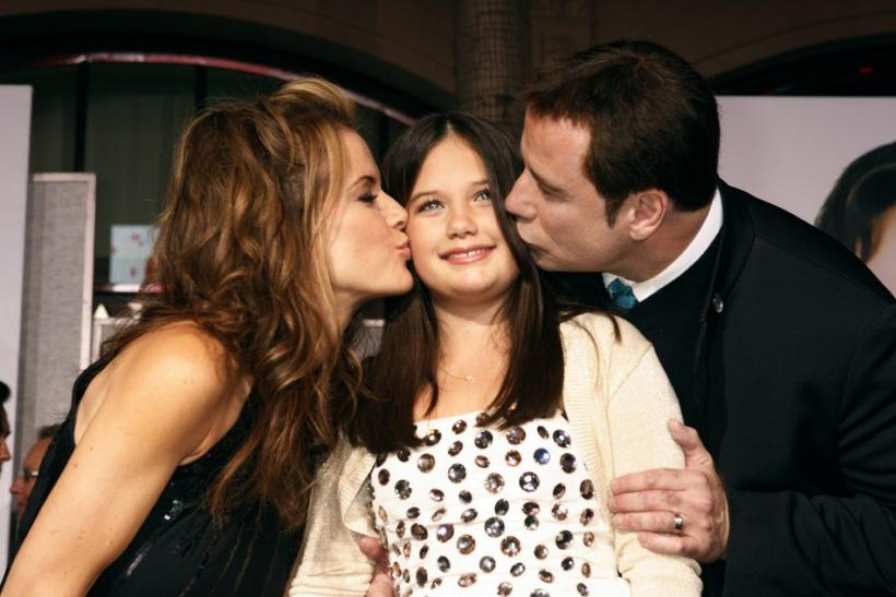 Actor John Travolta and wife Kelly Preston kiss their daughter Ella Bleu Travolta