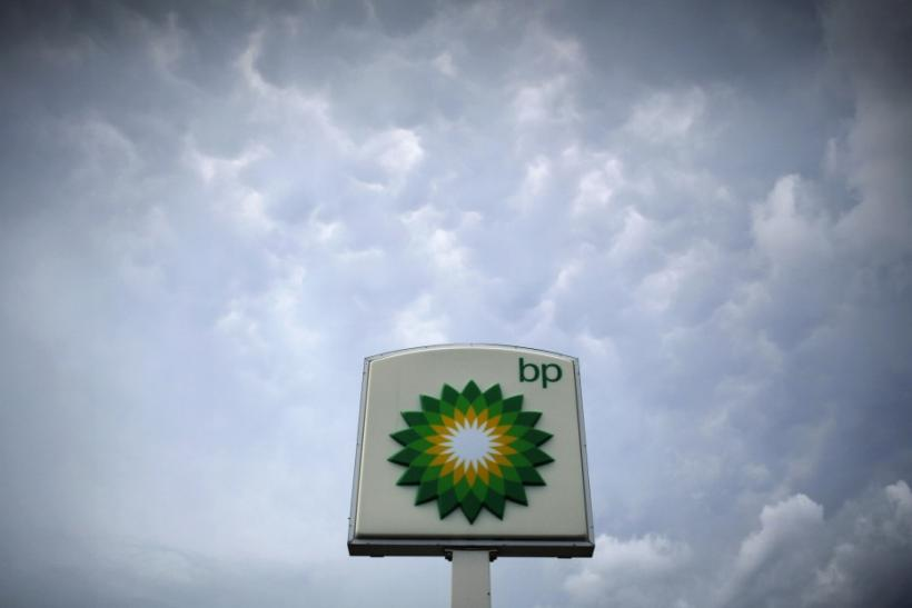 Storm clouds form near a BP station in Alexandria, Virginia July 19, 2010.