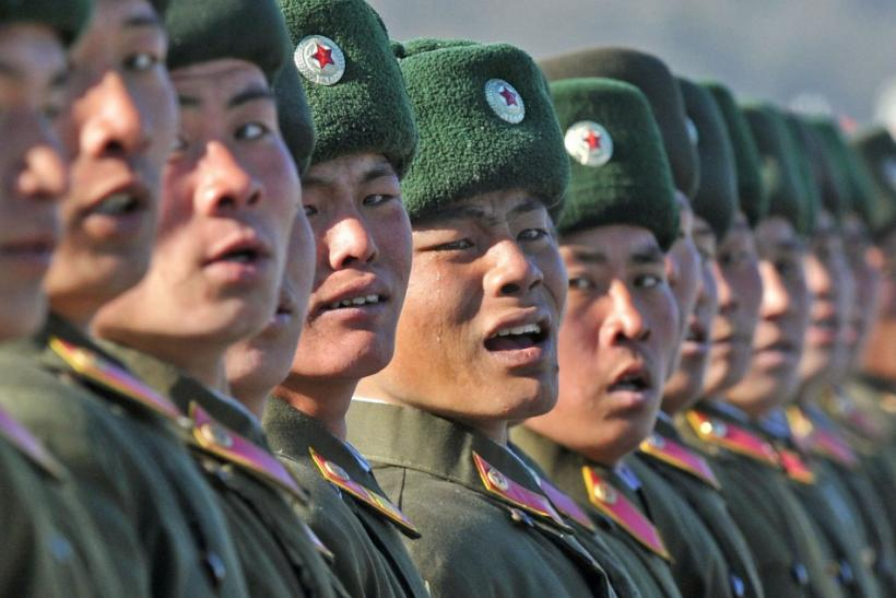 A North Korean soldier cries as he marches during a military parade to mark the birth anniversary of the North's late leader Kim Jong-Il in Pyongyang, in this photo taken by Kyodo, February 16, 2012.