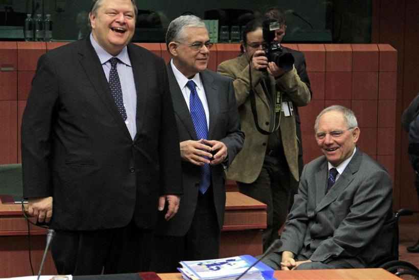 Greece's Finance Minister Venizelos, Greece's Prime Minister Papademos and Germany's Finance Minister Schaeuble attend a Eurogroup meeting in Brussels
