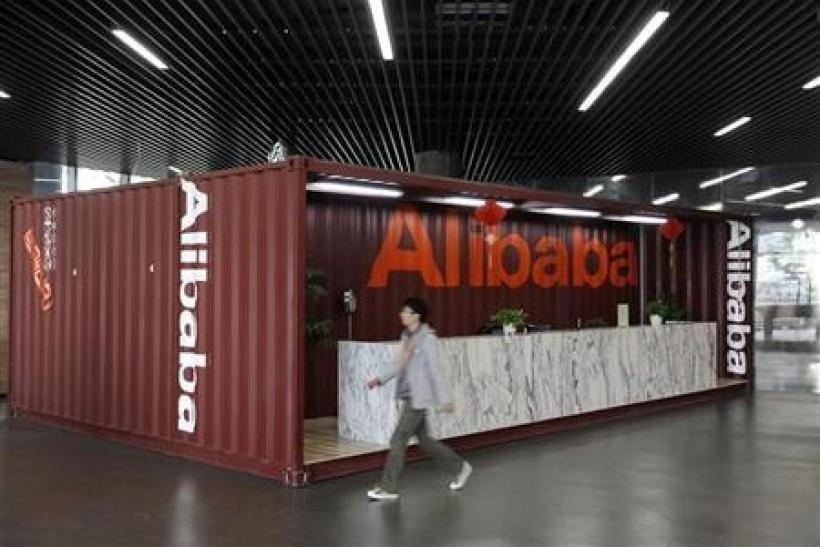 An employee walks inside the headquarters office of Alibaba (China) Technology Co. Ltd on the outskirts of Hangzhou, Zhejiang province March 16, 2010.