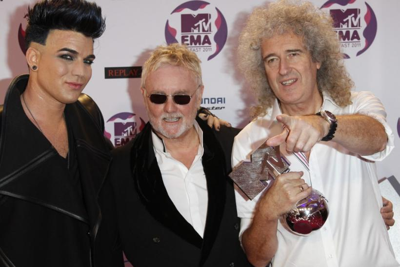 Adam Lambert poses after performing with Roger Taylor and Brian May of Queen at the MTV Europe Music Awards