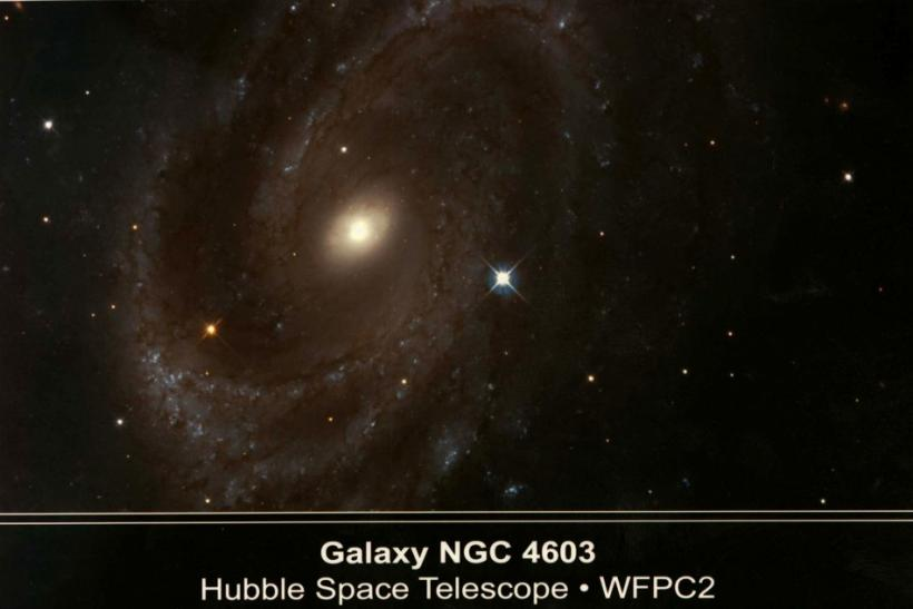 A NASA Hubble Space Telescope shows the spiral galaxy NGC 4603, the most distant galaxy in which a s..