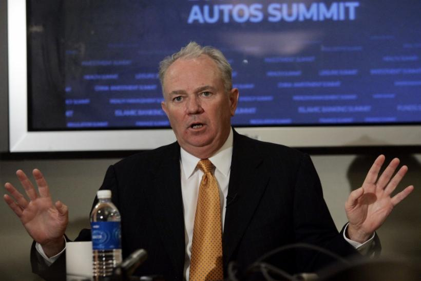 AutoNation CEO Mike Jackson talks with Reuters reporters during the Reuters Autos Summit in Detroit, Michigan