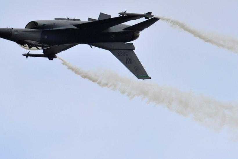 A General Dynamics F-16 Fighting Falcon fighter jet performs during an air display at the Farnborough Airshow