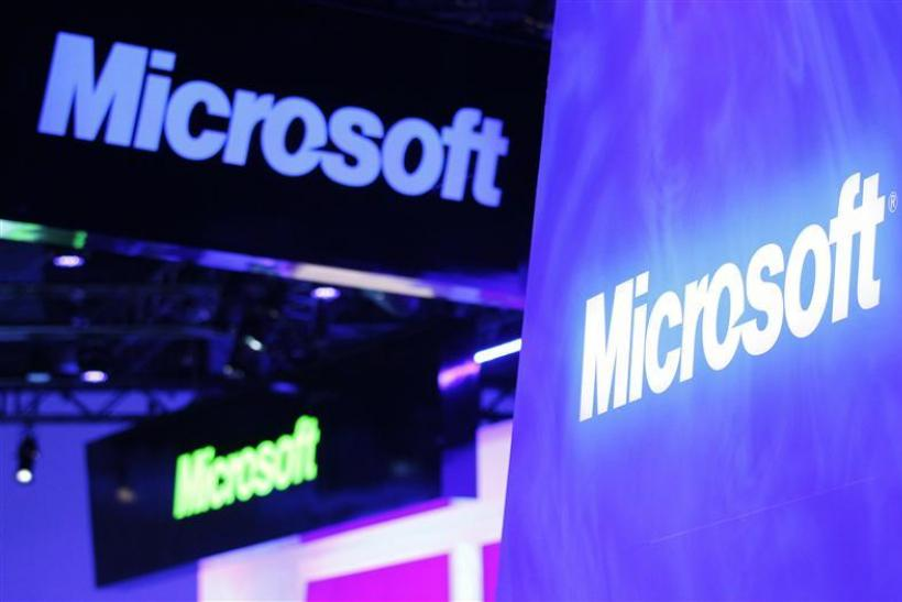 A variety of logos hover above the Microsoft booth on the opening day of the Consumer Electronics Show in Las Vegas