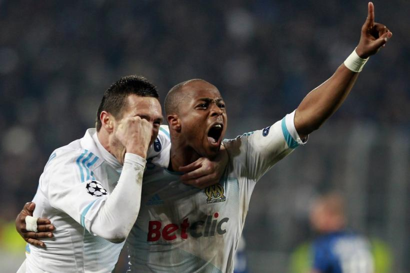 Olympic Marseille's Andre Ayew celebrates after scoring against Inter Milan during their Champions League soccer match at the Stade Vélodrome in Marseille